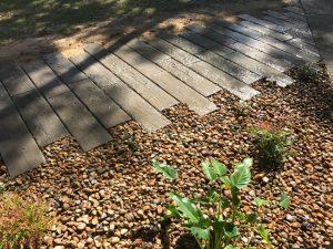 Rustic timber look railway sleeper path - landscaping Brisbane and Sunshine Coast