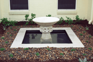 water feature - pond with river gravel surround in south east Queensland garden renovation