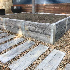 Rustic timberstone garden bed