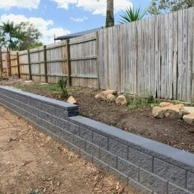 Charcoal Heron block retaining wall in a Brisbane landscaping Project by Instant Greenscene