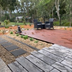 Landscaping Brisbane - Native garden with merbau decking and dry riverbed