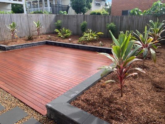 after landscape works complete Recliffe Queensland - Decking , charcoal heron garden wall, tropical garden